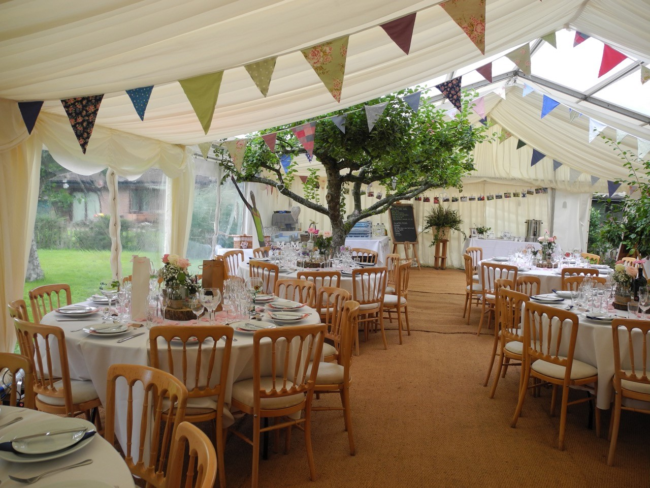 marquee wedding bunting in orchard