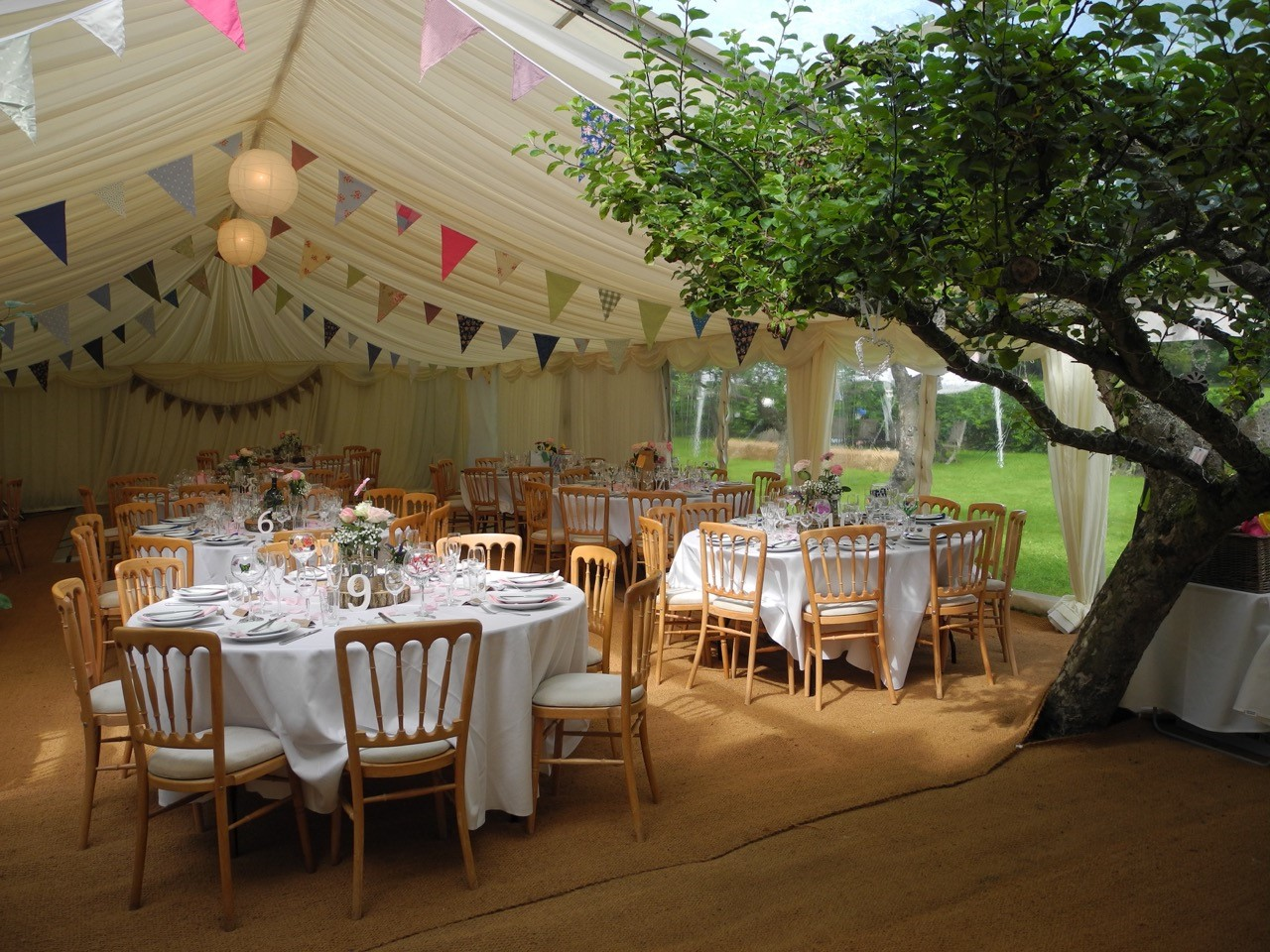 marquee bunting wedding in orchard
